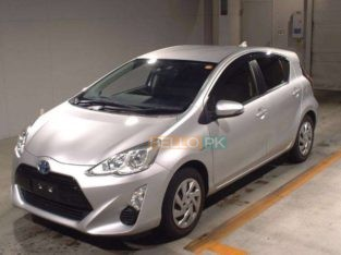Toyota Aqua 2015 ,Key start,ABS,PW,PS,64542 KM,Grade 4,Arrival At Karachi Port