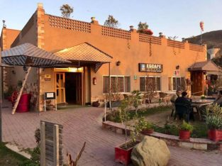 Escape Hotel Kallar Kahar.Stay in Natural Soothing Environment With Best Food